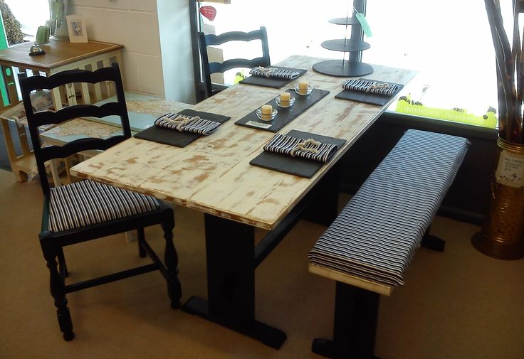 Navy Blue and white dining set. This set has has driftwood/scrubbed effect top as does the bench. All upholstered with white and blue striped material with matching serviettes.