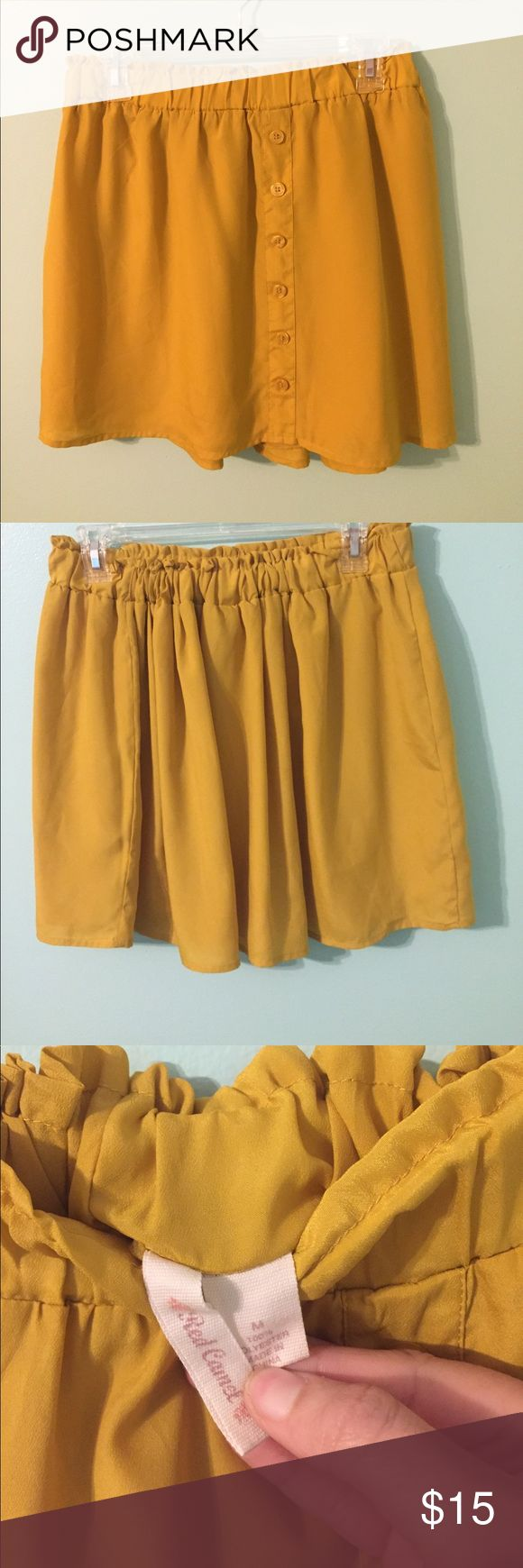 Mustard yellow skirt with faux front buttons Mustard yellow red camel skirt with faux front buttons. Has an elastic waste band. Red Camel Skirts