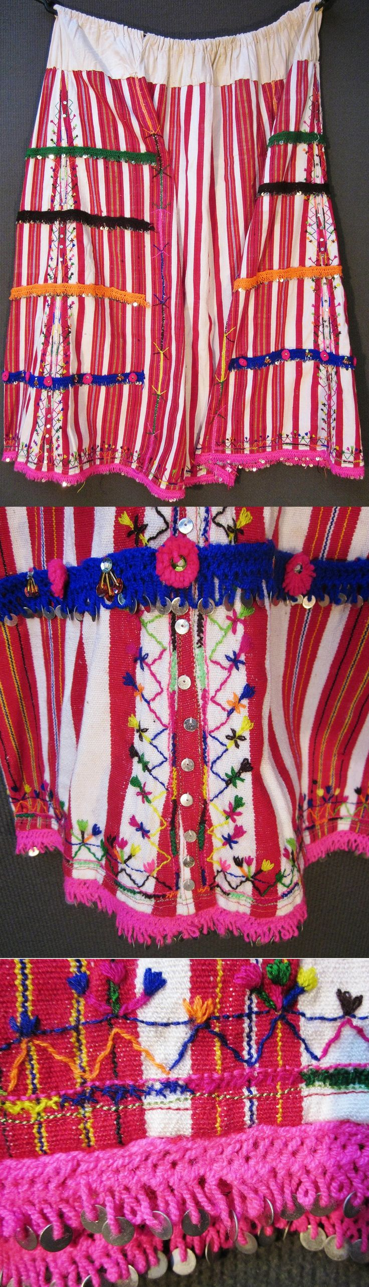 An embroidered cotton 'etek' (skirt)  from the Pomak villages near Biga (Çanakkale prov.).  Part of the traditional festive costume for women.  Circa 1950-1975.  Hand-woven fabric, adorned with (cotton & lurex threads) embroidery, metal & mica sequins, cotton crochet lace with metal sequins, glass beads and (cotton or orlon) pom-poms.  (Inv.nr. ete003 - Kavak Costume Collection - Antwerpen/Belgium).