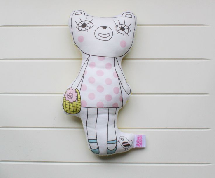 Gorgeous girl bear character softie from the Bears on Bikes story by Julia Staite.  Backed with fun yellow triangle fabric. These softies are super cute on their own or with the matching cushion.  Sweet pink for girls. There is a boys version too.     Handmade with love in the UK. Julia Staite is a fun and quirky kids and homeware brand based in the United Kingdom. All illustrations are designed by Julia, printed and then hand stitched.  Approx 30cm tall, made from 100% cotton and filled…