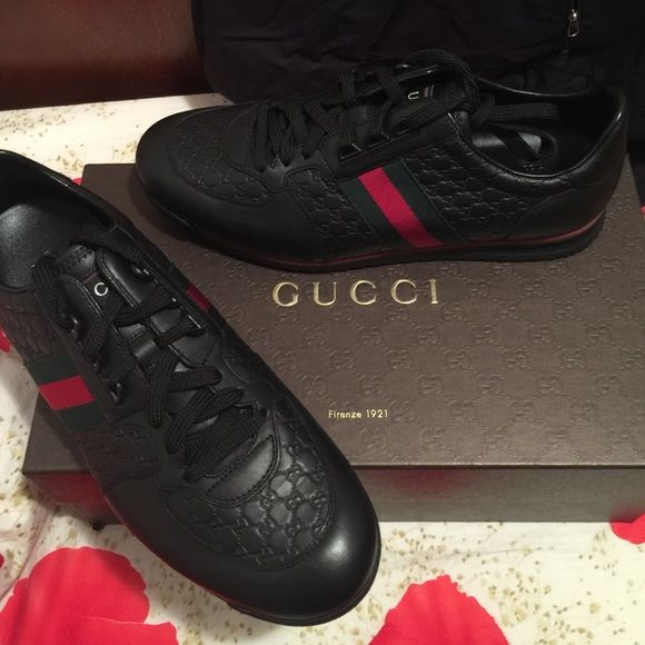Brand new Gucci men's shoes All new. Never worn. Black leather with green and red stripe on side. Gucci Shoes Sneakers