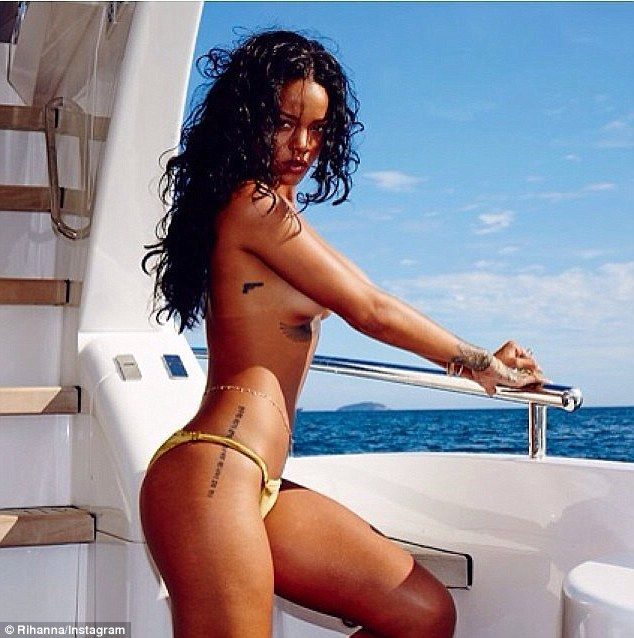 Flaunting it: Rihanna flaunts her inch-perfect beach physique as she poses topless in Brazil