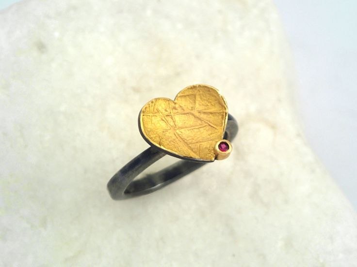 A modern gold oxidized silver heart ring with a genuine ruby and hammered band. by TomisCraft on Etsy