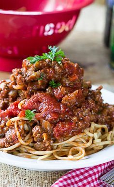 Southern Spaghetti Sauce adapted from Paula Deen _ just like my Grandmother made! Super thick & meaty! Two cans of tomato paste give it an extra intense flavor!