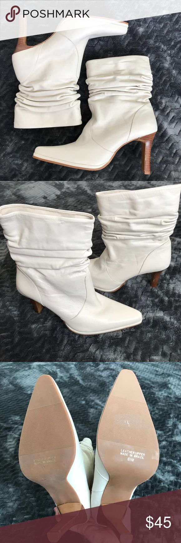 On-trend white ankle boots Get that off-duty-model look with these white ruched leather ankle boots.   Stiletto heel is about 3 inches high. Squared pointy toe. NWOB. Made in Brazil. Very light cream color, not paper-white.  The White Mountain brand is known for comfort and durability. White Mountain Shoes Ankle Boots & Booties