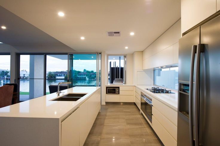 Organic White Kitchen by Costa Constructions