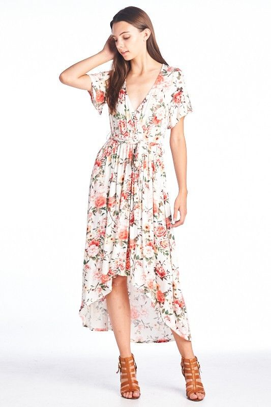 "Wrap front floral maxi dress in Ivory, Peach and Coral print. Nursing and maternity friendly. - Model is 5'6"" wearing a size small - Paired with our cream camisole - 95% rayon, 5% spandex"