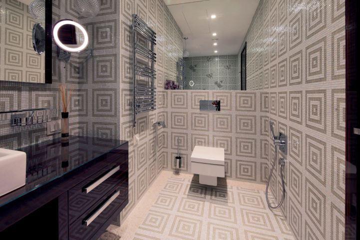Geometric patterned tiles in beautiful modern bathroom interior