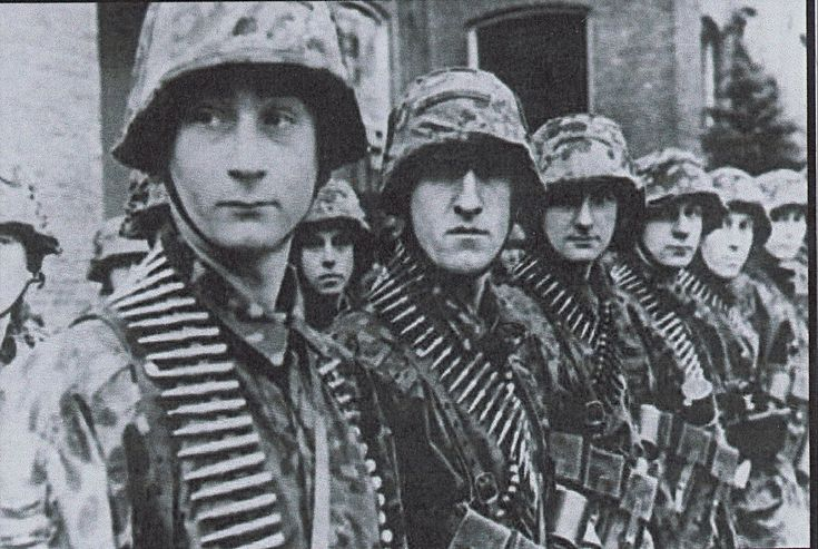 SS-Panzergranadiers of SS-Panzer-Aufklärungs-Abteilung 17, 17. SS-Panzergrenadier Division 'Götz von Berlichingen', heavily armed and ready to engaged in combat the paratroopers of the 101st Airborne Division near Carentan, Normandy. 11 June 1944.