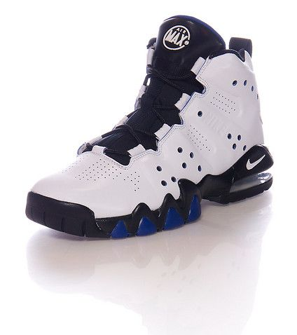 NIKE High top sneaker Lace front closure Contrasting accent colors Padded  tongue with AIR MAX logo