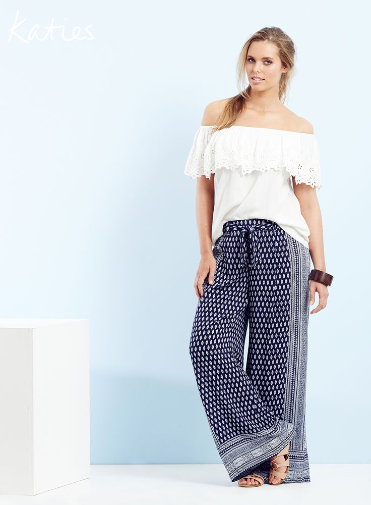 BOHEMIAN CHIC / Comfort meets style with this off the shoulder tops and easy breezy palazzo pant. Lace detailing and a bold bohemian inspired print will effortlessly lift your off duty style.