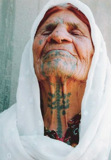 Kurdistan | The 'tree of life', which in ancient times is said to have reached the skies, is one of the most common symbols used in Kurdish tattoos. It represents immortality. This tattoo starts between the breast and climbs upwards towards the chin like a vine. | ©Ilhan Bakir