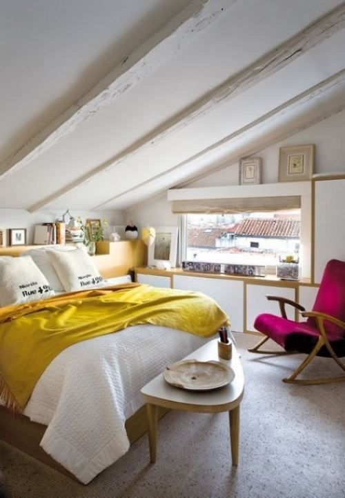It's important to give a lot of thought to the colours you use in your attic bedroom - here, predominantly pale colours have been used, with an occasional pop of bright colours to add interest.