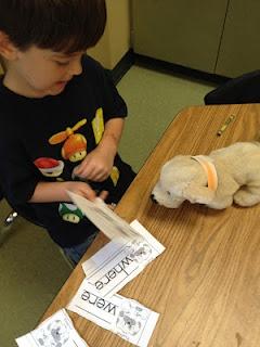 Teach a puppy to read!  This is so cute. :)