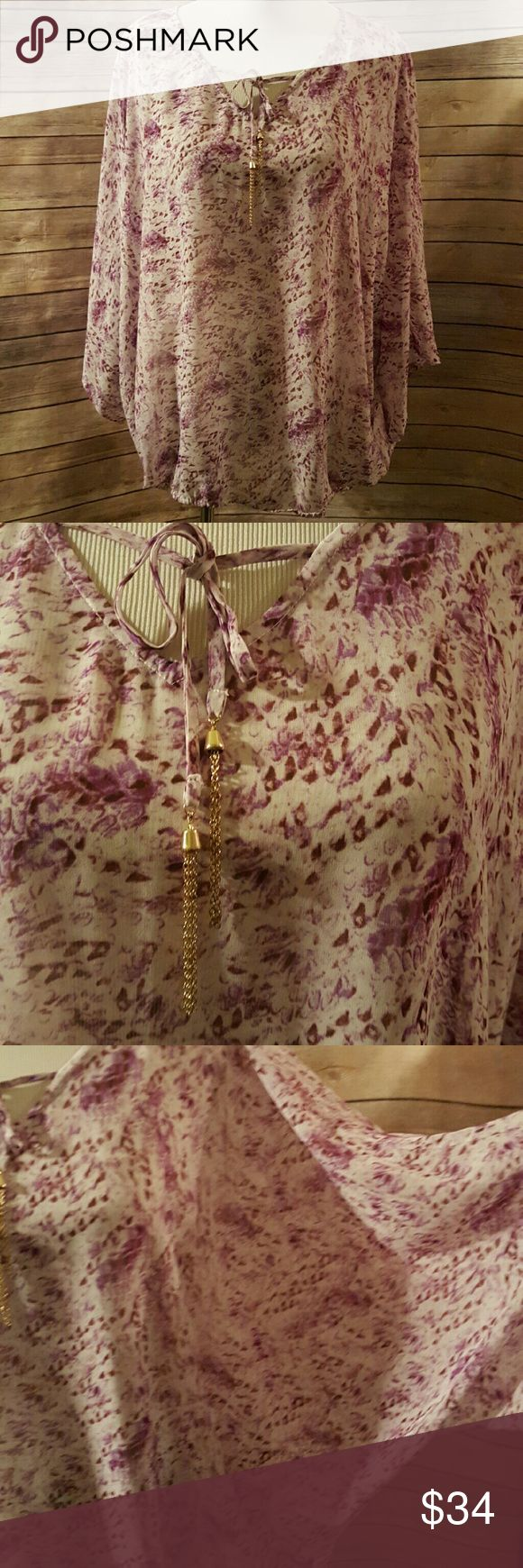 Purple plus size blouse Jessica Simpson size 3x.  Elastic bottom. Dolman/batwing sleeves.  Beautiful purple floral.  Has gold tie accent on neckline. Jessica Simpson Tops