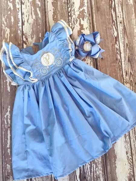The Ella DressA beautiful cornflower blue dress, cream lace trim and an ornate carriage design. Sizes start at 6 months and go to a size youth12. The perfect dr