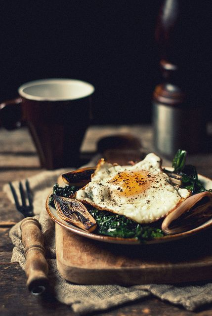 The shadows and darkness are stunning in this image. I love the setup and how the neutral colors allow the color of the egg to really pop. #bywstudent
