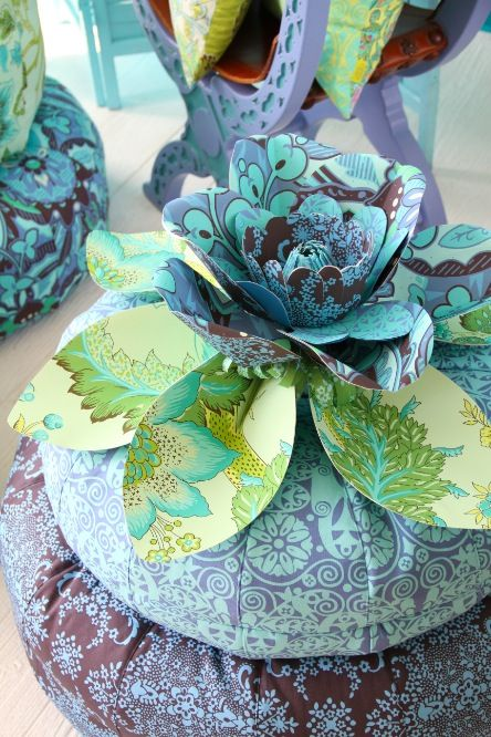Variation of the Honey Bun Pouf from Amy Butler Design.  She has an amazing line of bright, colorful, fresh printed fabrics.  I could create an entire board using images from her website.