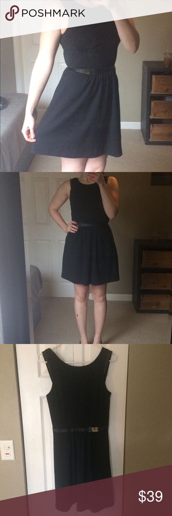 Jennifer Lopez cocktail dress Beautiful black dress with v-cut front and back and cute fake leather detailing. Worn once for a Christmas party and I've just outgrown it. Professionally dry cleaned Jennifer Lopez Dresses Midi