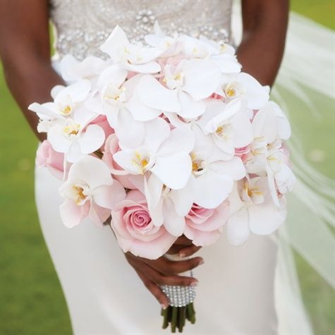 color palette of silver, cream and blush. Kamika carried soft-pink roses and white phalaenopsis orchids