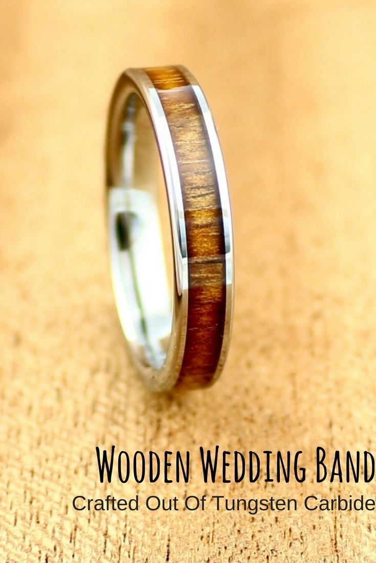 Mens or womens wood wedding band. This wood wedding band is crafted out of silver tungsten carbide and has a high polis finish. We used real koa wood and inlaid it through the center of this ring.