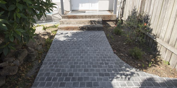 Our Ash Bluestone Cobblestone is cut from the densest blocks to ensure strength and durability enough to use on high traffic areas or on driveways. With its slight olive colour, these cobbles have an earthy colour tone. #drivwaystones #cobblestones #cobble #cobbletiles #drivewaypavers #moderndriveway #exteriorpaving #landscapearchitecture