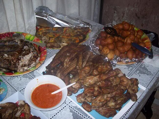 Congo - party food consisting of ribs, chicken, mikate, cooked fish, grilled fish, red hot pepper