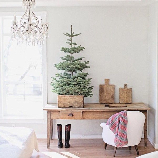 For The Minimalist - There's no rule that you have to decorate your Christmas tree. In fact, there's something super stylish about leaving your tree natural, especially when it's small enough to be placed in a vintage wooden box or crate. Sometimes less really is more.