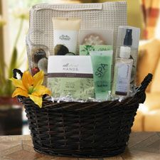 Spa gift basket filled with goodies to pamper and a cotton robe to fit with your 2nd anniversary. More cotton anniversary gift ideas http://www.anniversary-gifts-by-year.com/cotton-anniversary-gifts.html for silent auction in Preseason Banquet