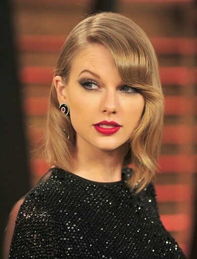 Taylor swift side swept bangs