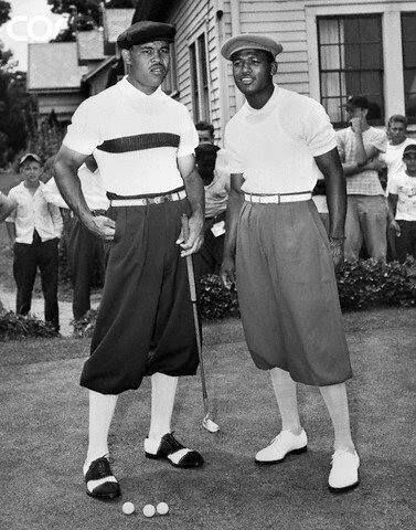 Joe Louis and Sugar Ray Robinson in golfing togs