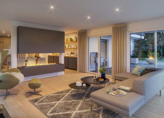 Bungalow Haus Innen Modern Mit Grossem Kamin Als Raumteiler Ideen