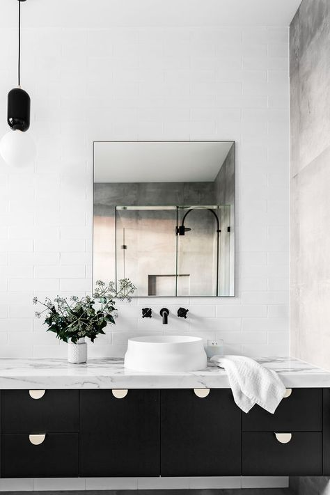 OMVIVO's Latis round basin is the feature in this stunning bathroom by Sutcom Constructions in Brisbane and we can't get enough of it! Beautiful contrast between the marble bench top and the dark vanity.