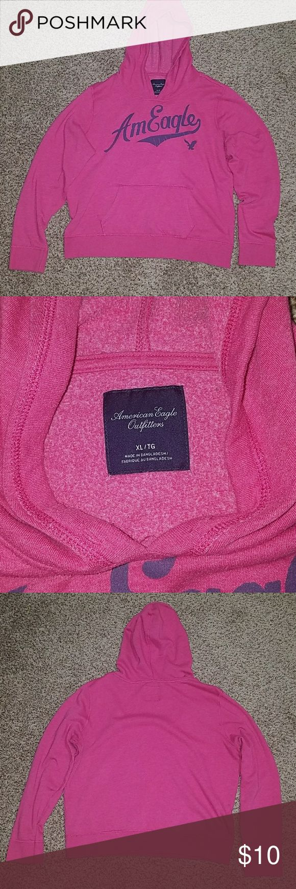 American Eagle pink womens hoodie EUC pink hoodie with blue writing on the front.  Very soft and comfy.  Has hand pouch in the front as well. American Eagle Outfitters Tops Sweatshirts & Hoodies
