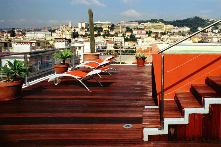 Places: Hi Hotel: the atypical lux of Matali Crasset | On the top-floor terrace, guests can sunbathe while enjoying the view over the city.  © Hi Hotel