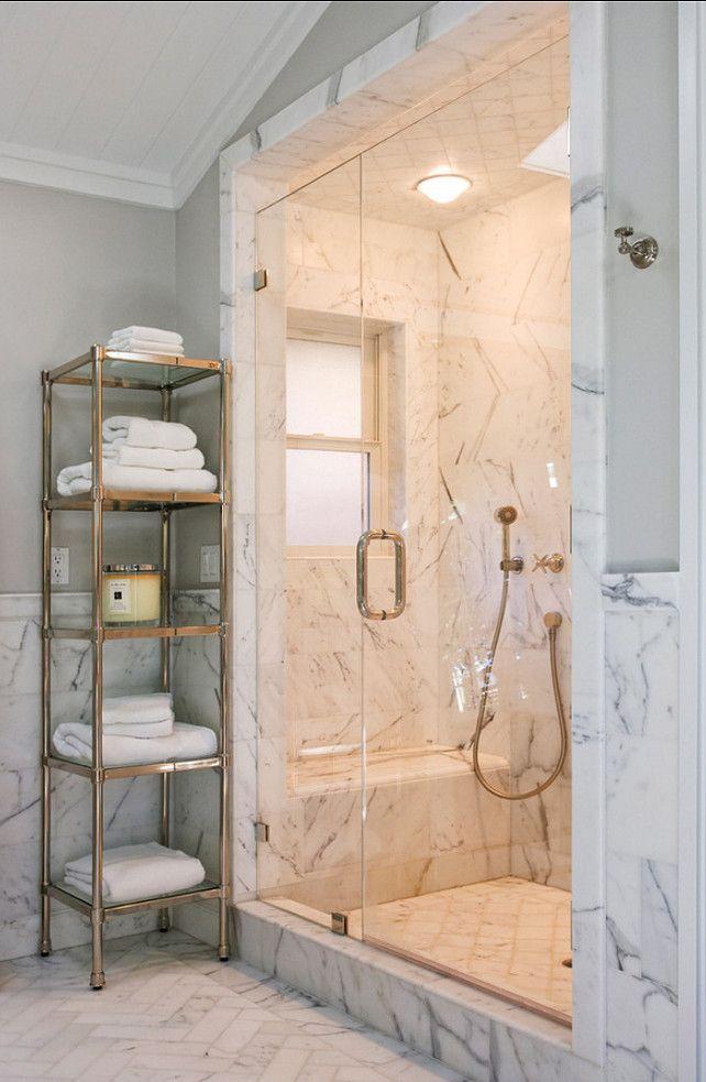 marble shower, brass hardware, marble chevron tile