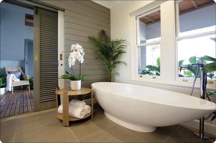 Beach bathroom,  grey bathroom, modern classic, orchid, beach house, freestanding bath, beach wall texture, horizontal stripes, wall cladding, shutters, outdoor shower