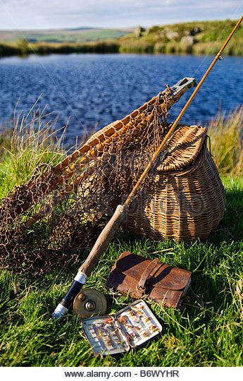 UK, Wales, Conwy, Pentrefoelas. A split-cane fly rod and traditional fly-fishing equipment beside a trout lake in North Wales - Stock Photo