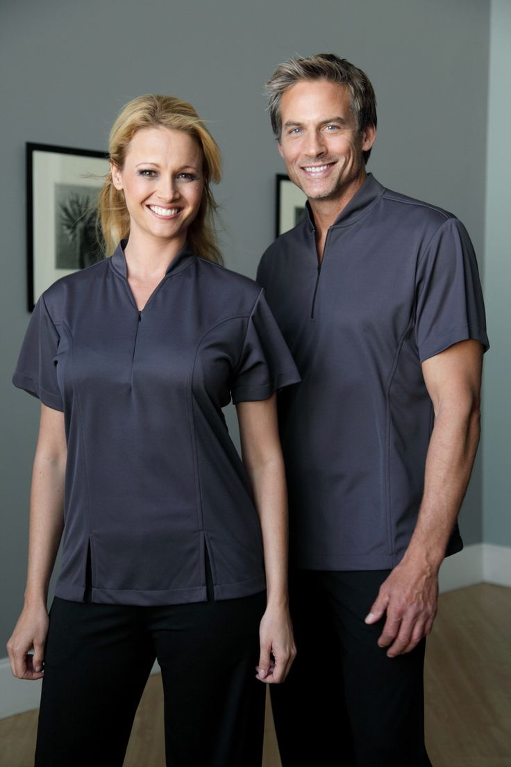 "Spa Uniforms that feature -100% Stretchable & Breathable ""Spa-Dri Performance Fabric - Exclusive to Yeah Baby -perfect for warm weather properties. Ladies Siena #7117D - Charcoal Spa Dri Mens Sonello # 7217D -Charcoal Spa Dri Shown with Black ""Spa Dri"" Pant Spa-Dri is available in many colors"
