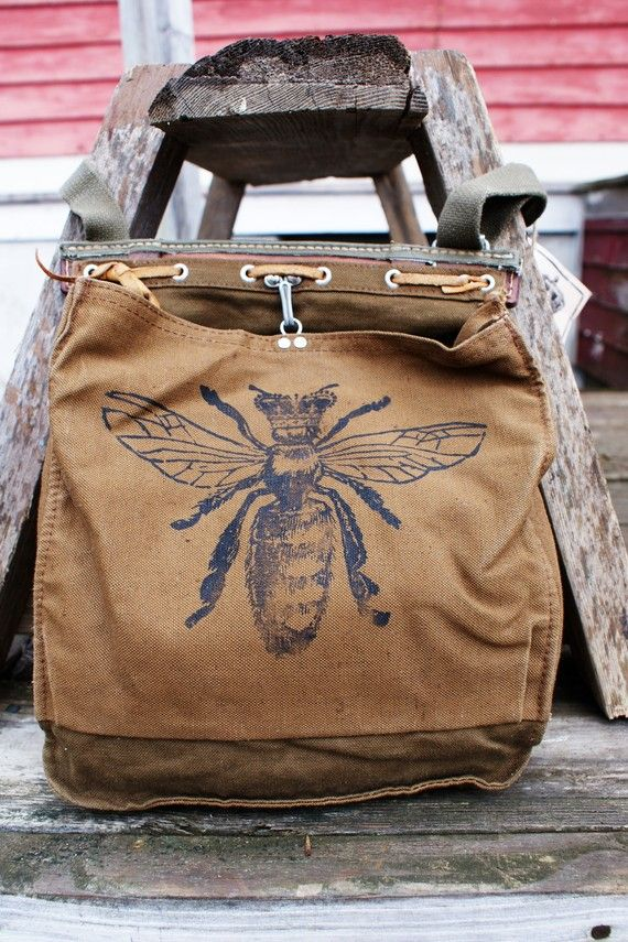 Queen Bees rule the hive. With this bag, youre sure to rule the world. Our original crowned bee image has been screen printed by hand in black ink on