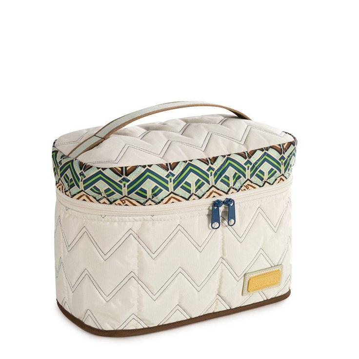 The cinda b Grand Train Case in Ravinia Ivory is an ideal large cosmetic bag big enough for all your cosmetics and toiletries.  It is machine washable, stain resistant, water resistant and proudly made in America.  www.cindab.com