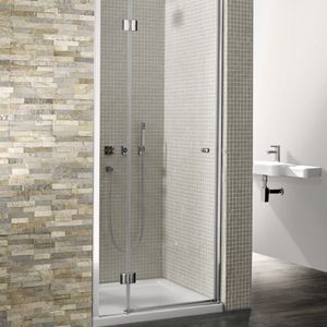 http://www.mobilehomerepairtips.com/howtocleanglassshowerdoors.php has some information on various methods on how to clean glass shower doors.