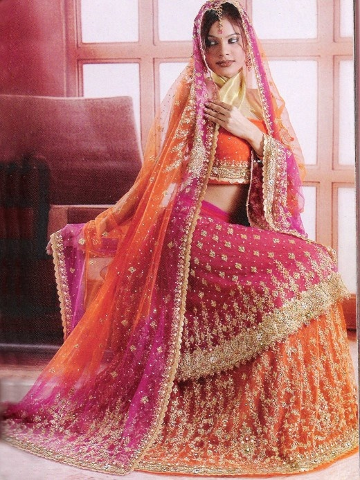 Orange and dark pink net lehenga choli with having dupatta for Pink and orange wedding dresses