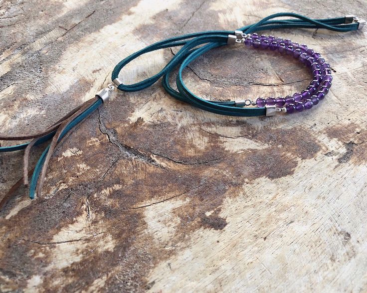 Amethyst and green suede boho style long necklace #bohostylenecklace #amethystnecklace #purplestonenecklace #greensuedenecklace #bohonecklace #beadednecklace #beadworkjewelry #fashionaccessories #womensaccessories A personal favourite from my Etsy shop https://www.etsy.com/uk/listing/575679583/amethyst-natural-gemstone-green-suede
