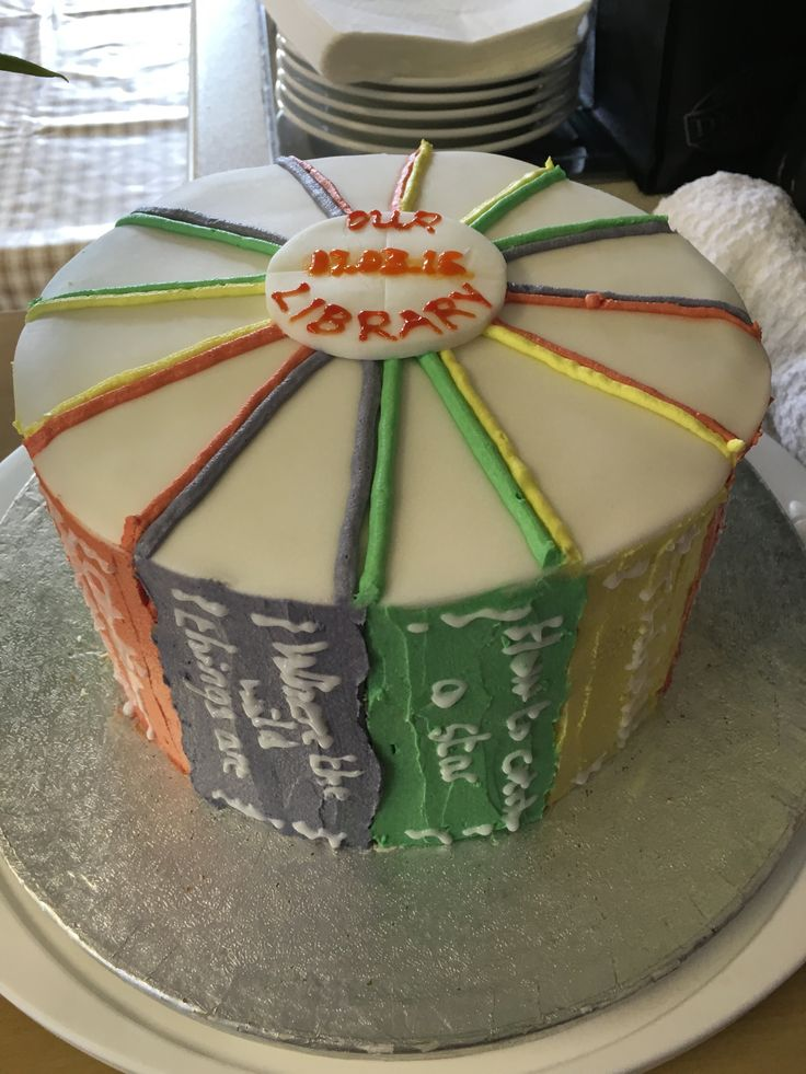 3 tier coffee cake for opening of school library decorated with book titles