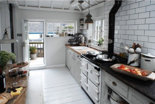 Well equipped rustic style kitchen with range cooker and Smeg fridge