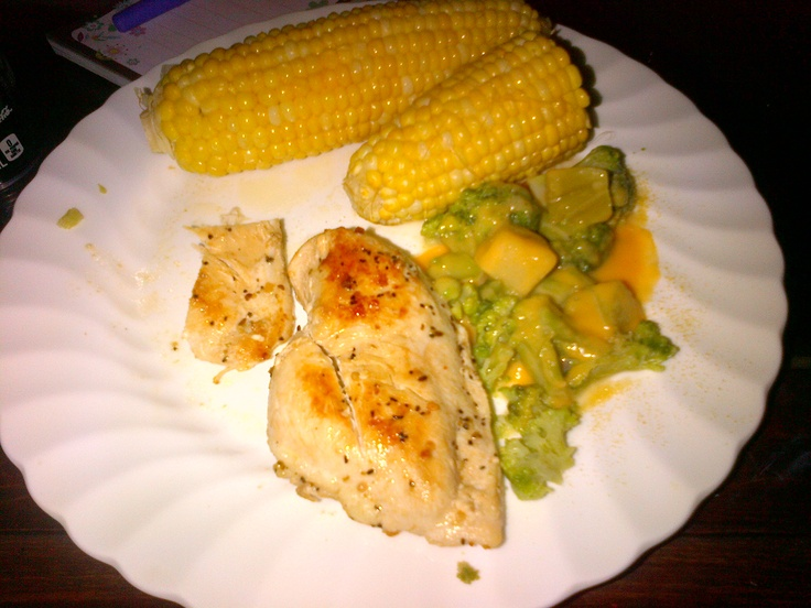 Montreal Peppered Chicken with Garlic Cheese Broccoli and Corn on the Cob