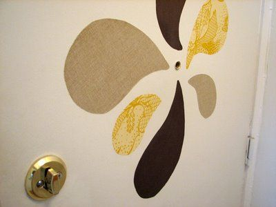 Starching fabric to your wall!  Just peal off when you don't want it anymore and it doesn't ruin the paint!