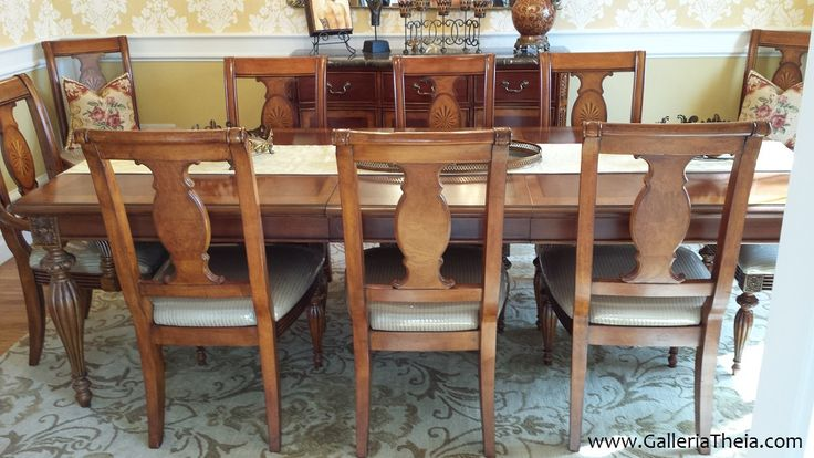 Upscale Cherry Dining for Any Season Intricately carved hardwood with fine wood veneer finish.  Domain dining collection includes expandable table, 2 leaves, 2 host and 8 sidechairs, plus a marble top buffet.  For sale, with details at http://wp.me/p7LhJk-cE