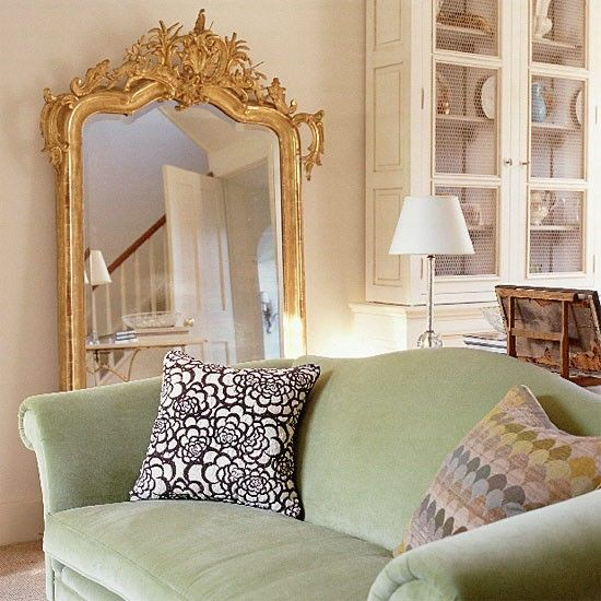 classic living room with sage green velvet sofa with